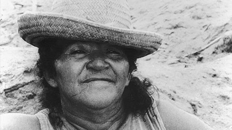 Black and white photo of an Amazon lady wearing a hat.